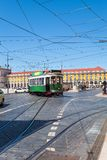 Commerce Square with a beautiful green tram, Lisbon, Portugal. Commerce Square with a typical tram passing by, Lisbon, Portugal royalty free stock image