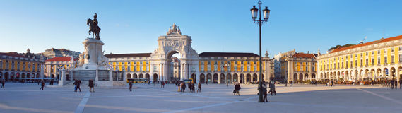 Commerce Square evening panorama. Lisbon, Portugal - February 10, 2015: People walk at the Commerce Square near Statue of King Jose I and Arch in the evening in Stock Photography