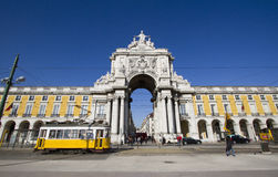 Commerce square in Lisbon, Portugal. LISBON, PORTUGAL - JAN 5:Stone arch at Terreiro do paco, Commerce square and famous yellow tram in Lisbon on January 5, 2012 Royalty Free Stock Photo