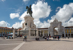 Commerce Square in Lisbon, Portugal. LISBON, PORTUGAL - APRIL 13, 2016: Tourists exploring Triumphal Arch and King Jose I bronze statue in the iconic Commerce royalty free stock photo