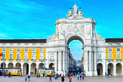 Commerce Square. Lisbon, Portugal. LISBON, PORTUGAL - DECEMBER 12, 2014: People walking at Rua Augusta Arch on the Commerce Square - tourist attraction in Lisbon Royalty Free Stock Photos