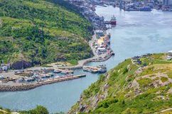 Commerce, trade, ships of all kinds lined up along St John`s Harbour in Newfoundland Canada. royalty free stock image