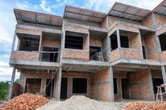 Commerciële gebouwen in aanbouw stock afbeeldingen