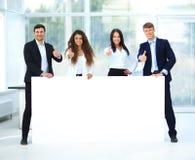 Commerciële groep met banner Stock Fotografie