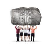 Commerciële grote team opheffende tekst van droom royalty-vrije stock afbeelding
