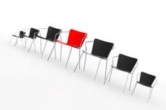 Commerciële grote vergadering Rood Chef- Chair Between andere Stoelen ren Royalty-vrije Stock Foto's