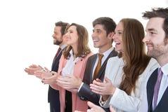 Commerciële teamgroep het toejuichen in vergadering Royalty-vrije Stock Afbeelding