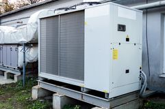 Gray commercial AC unit for central ventilation system. Commercial AC unit for central ventilation system Stock Image