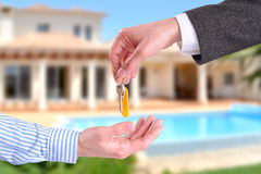 Commercial agent giving keys to customer horizontal composition Stock Images