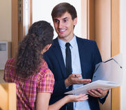 Commercial agent greeting householder and selling subscriptions Stock Photos