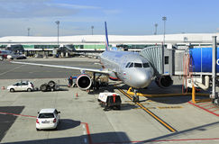 Commercial aircraft being serviced on the tarmac Royalty Free Stock Photography