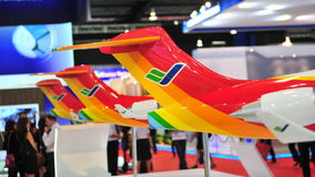 Commercial of Aircraft Corporation of China (COMAC) booth showcasing ARJ21 executive jet at Singapore Airshow. SINGAPORE - FEBRUARY 12: Commercial of Aircraft stock photography