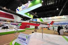 Commercial of Aircraft Corporation of China (COMAC) booth showcasing ARJ21 executive  jet at Singapore Airshow Royalty Free Stock Images
