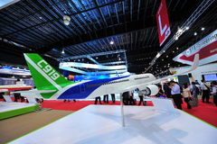 Commercial of Aircraft Corporation of China (COMAC) booth showcasing C919 twin jet passenger plane at Singapore Airshow. SINGAPORE - FEBRUARY 12: Commercial of royalty free stock photography