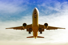 Commercial Aircraft landing. Bottom view of the landing maneuver of a commercial plane Royalty Free Stock Photography