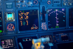 Commercial aircraft panel at night. Airplane Instruments primary flight display stock image