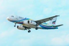 Commercial Airliner from Bangkok Air Landing in Phuket Stock Photos