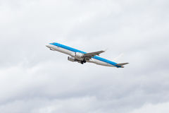 Commercial airliner flying midair after takeoff Royalty Free Stock Photography