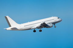 Commercial airliner flying midair after takeoff Stock Image