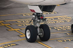 Commercial airliner undercarriage on tarmac. Front under carriage of large commercial airliner, on tarmac Royalty Free Stock Photos