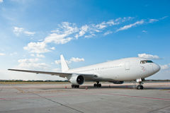 Commercial airplane at the airport. Commercial airplane parking at the airport Stock Photos