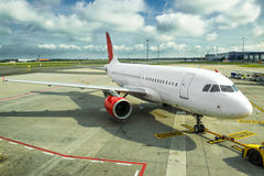 Commercial airplane at the airport Royalty Free Stock Images