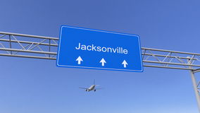 Commercial airplane arriving to Jacksonville airport. Travelling to United States conceptual 3D rendering. Commercial airplane arriving to Jacksonville airport Royalty Free Stock Image