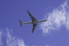 Commercial Airplane in blue sky Stock Images