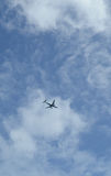 Commercial Airplane in blue sky Royalty Free Stock Images