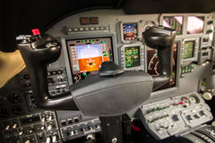 Commercial airplane cockpit interior view. Instrument panels in cockpit of a very modern private business jet at night Stock Image