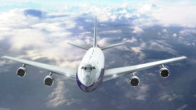 Commercial airplane flying above the clouds stock video