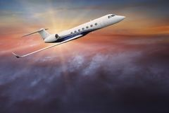 Commercial airplane flying above clouds. Royalty Free Stock Photography