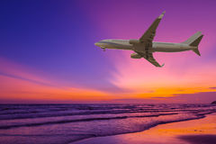 Commercial airplane flying above the sea Stock Photography