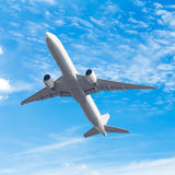 Commercial airplane flying with blue sky background with clip Royalty Free Stock Photo