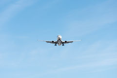 Commercial airplane flying in blue sky, full flap and landing ge Royalty Free Stock Photography