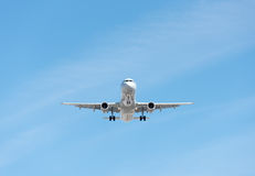 Commercial airplane flying in blue sky, full flap and landing ge. Ar extended Royalty Free Stock Image
