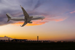 Commercial airplane flying over the airport Royalty Free Stock Images