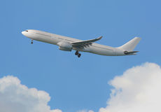 Commercial Airplane flying in the sky Stock Images