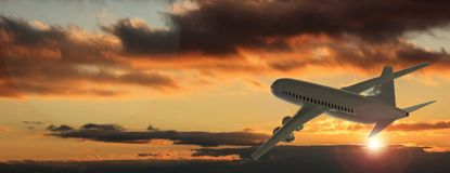Airplane on sunset or sunrise sky background. 3d illustration. Commercial airplane with four engines flying on sunset or sunrise sky background, side back view Stock Photos