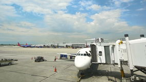 Commercial airplane on the gate at Midway airport in Chicago stock video footage