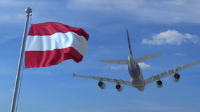 Commercial airplane landing behind waving Austrian flag. Travel to Austria conceptual 3D rendering. Commercial airplane landing behind waving flag Royalty Free Stock Photos