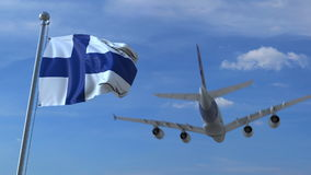 Commercial airplane landing behind waving Finnish flag. Travel to Finland conceptual 3D rendering. Commercial airplane landing behind waving flag Stock Photography