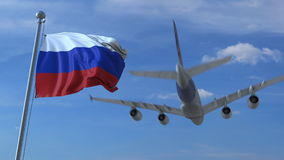 Commercial airplane landing behind waving Russian flag. Travel to Russia conceptual 3D rendering. Commercial airplane landing behind waving flag Stock Photos