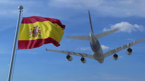 Commercial airplane landing behind waving Spanish flag. Travel to Spain conceptual 3D rendering Stock Image