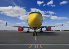 Commercial airplane parked on an airfield Stock Photo