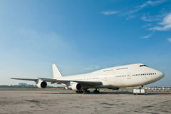 Commercial airplane parking Stock Image