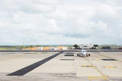 Commercial airplane on parking strip at airport Stock Photography