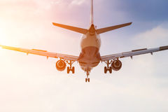 Commercial airplane in the sun stock images