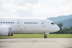 Commercial airplane taxiing. Front of a commercial airplane taxiing stock images