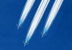 Commercial airplanes flying in blue sky. The concept for the business travel and tourist travel. Commercial airplanes flying in blue sky Stock Photography